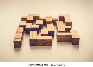 Abstract Background. Different shapes wooden blocks on white background. Concept of creative, logical thinking or problem solving. Toned photo