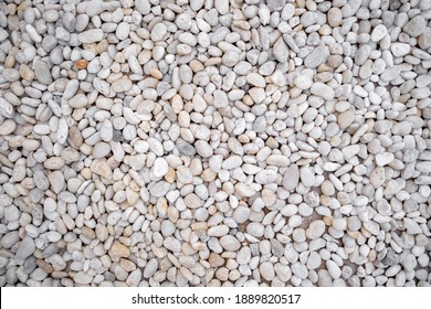 Abstract background of dry round stones texture backgorund