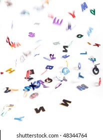 abstract background of falling letters with motion blur on a white background