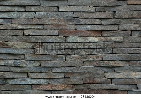 Abstract background: fence in the form of stones.