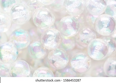 Abstract background of glassy nacre balls.  Flat lay. Selective Focus. Shallow DOF.