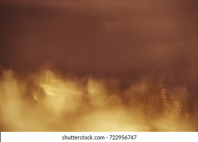 abstract background. Golden sparks and a cloud of dust