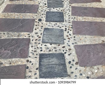 Abstract background of granite old cobblestone pavement. Paving texture