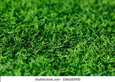 Abstract background of green artificial turf, textures background, field for game. Close-up