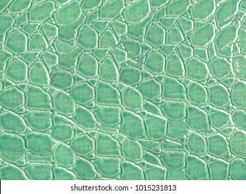 Abstract background of green color of fake leather