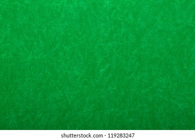Abstract background of green felt on casino table