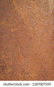 Abstract background of grunge metal sheet.Steel wall mats sprayed red rust.Iron surface rust background.