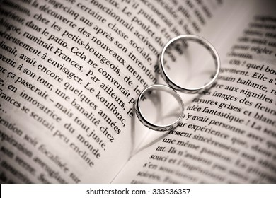 Abstract background of heart shadow with old ring on a book and first love wording