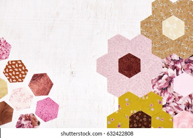 Abstract background of hexagonal pieces of fabric Grandmother's Flower Garden quilt