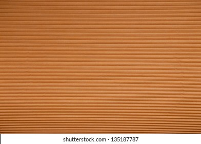 Abstract Background : Horizontal lines of light brown, cellular blinds filling the screen.