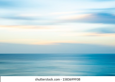 Abstract background horizontal seaside blur in blue hues.