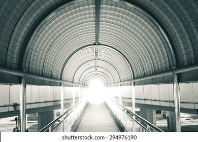Abstract background of light at the end of the way. ?Black and white tone.