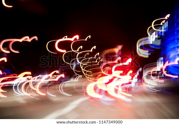 Abstract background, lights of the night highway, light trails on the road