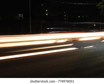 Abstract background of Long exposure vehicle light trails, night photography, noisy and blurred