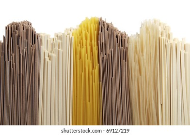 Abstract background made of different types of spaghetti on white background