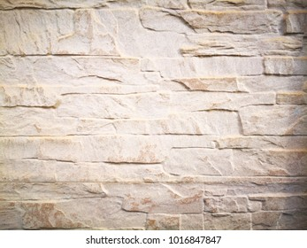 Abstract background made with rough tile. Closeup view of light brown rough tile. Tile texture and background for wall design. Texture of rough tile and copy space.