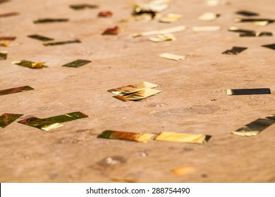Abstract background with many falling gold confetti pieces