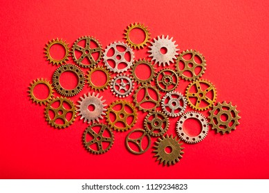 abstract background of metelic gear whell on red background