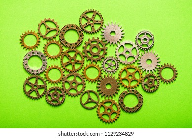 abstract background of metelic gear whell on green background
