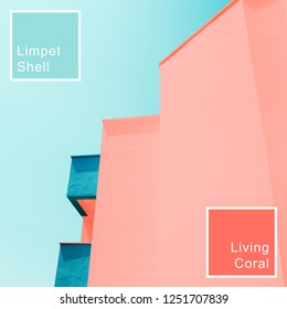 Abstract background with modern building toned in trendy colors of the year 2019. Living Coral and Limpet Shell.