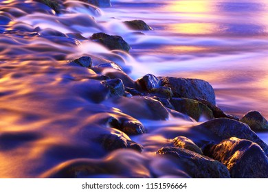 Abstract background of mountain river in moonlight at night.