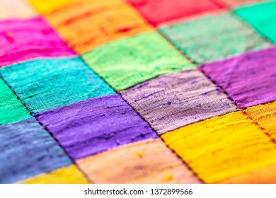 abstract background of multi-colored check fabric texture