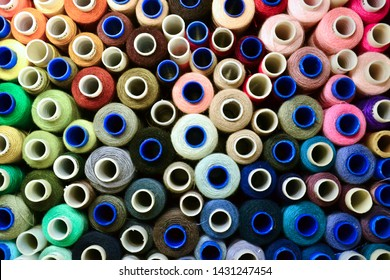 abstract background with multicolored spools of thread