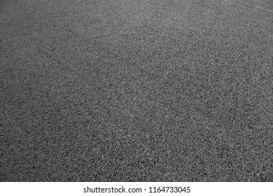 Abstract background. New black asphalt close up.