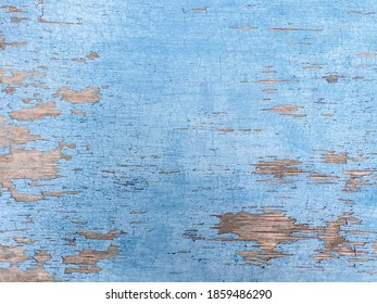Abstract background, old blue paint cracked wooden surface. Wooden retro surface, selective focus, shallow depth of field