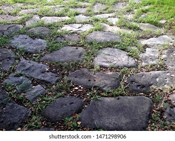 Abstract background. Old cobblestone pavement close-up.