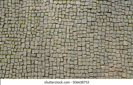 Abstract background of old cobblestone pavement view from above
