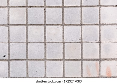 Abstract background old cracked square ceramic tile. Great background or texture.