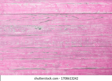 Abstract background from old pink wooden board with grunge and scratched. Vintage and retro backdrop.