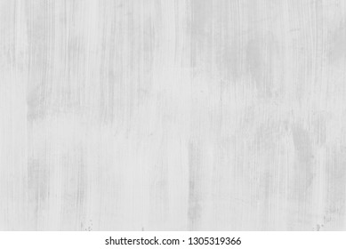 Abstract background from old wall. White color painted on concrete wall with grunge and scratched. Vintage and retro backdrop.