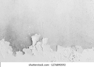 Abstract background from old white concrete wall with peeled off color surface. Retro and vintage backdrop.