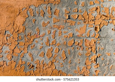 Abstract Background with  Orange Paint Scrapings on a Wall forming Patterns