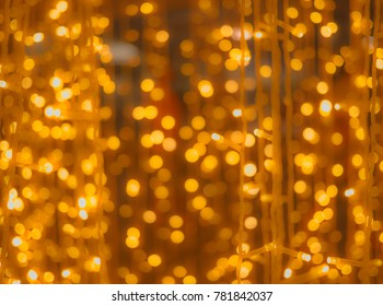 Abstract background of orange yellow light blub on wire in bokeh bubble shape
