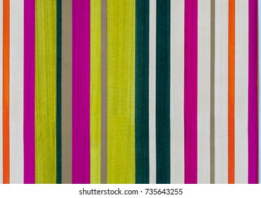 Abstract background paper pattern with vivid colored stripes.