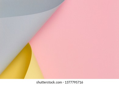 Abstract background. Pastel pink, yellow, blue color paper in geometric shapes