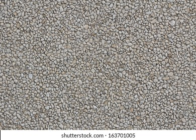 Abstract background paving consisting of small pebbles embedded in cement