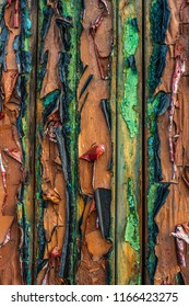 Abstract Background Of Peeling Paint On A Wooden Building