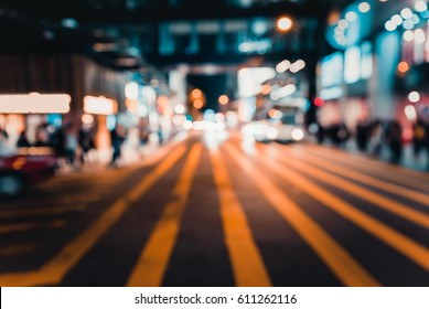 Abstract background of People across the crosswalk at night on Hong kong