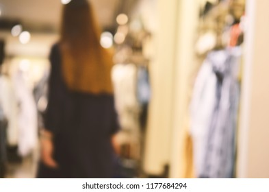 Abstract background - people shopping.  Clothes store. Blurry background