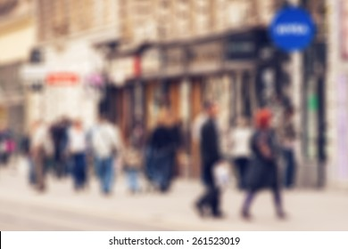Abstract background - people shopping and walking in main shopping street in Zagreb, Croatia - lens blur effect defocusing filter applied, with vintage instagram look.