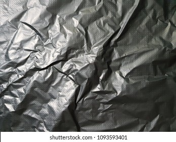 Abstract background photo texture. Black polyethylene packing film