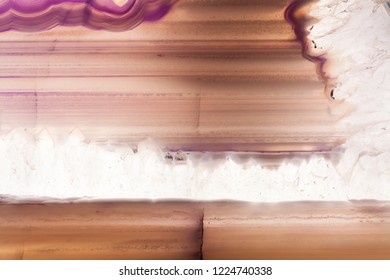 Abstract background, pink and brown striped agate slice mineral