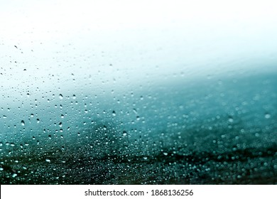 abstract background of rain drops on windshield.