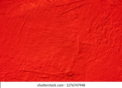 Abstract background from red concrete wall. Brush painted texture with scratched on surface wall.