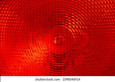 Abstract background of red faceted plastic reflective surface sign or rear lamp of taillight