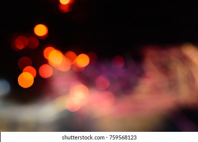 Abstract background of red yellow bokeh ligth at dark night